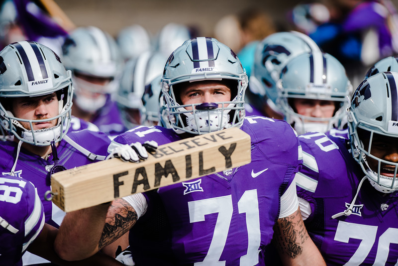 Offensive lineman Dalton Risner holds the family block, prepared to bolt out before the start of the K-State football game against Oklahoma State in Bill Snyder Family Stadium on Oct. 13, 2018. The Wildcats defeated the Cowboys 31-12. (Meg Shearer | Collegian Media Group)