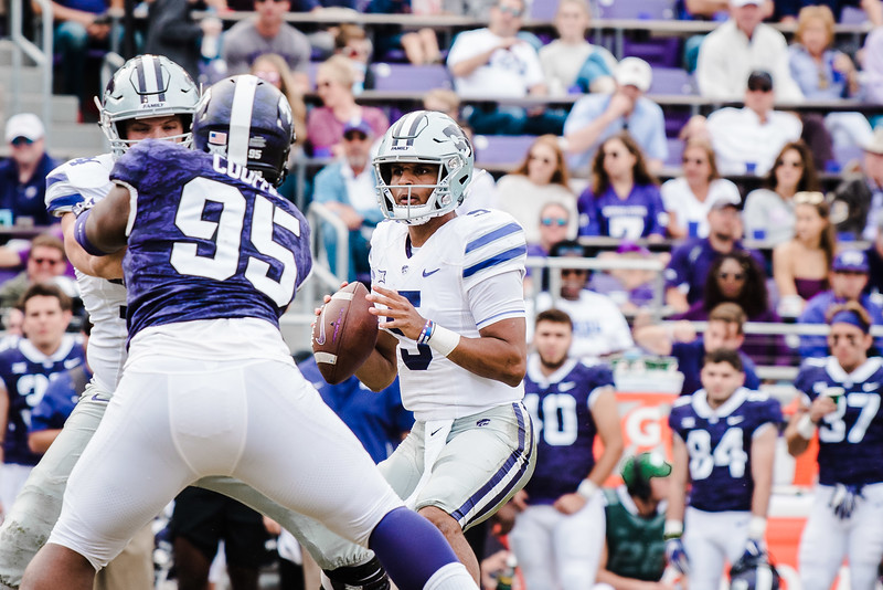 Looking for his next move, quarterback Alex Delton prepares to throw the ball to his teammate at the game against TCU Nov. 3. K-State lost against TCU 14-13. (Meg Shearer | Collegian Media Group)