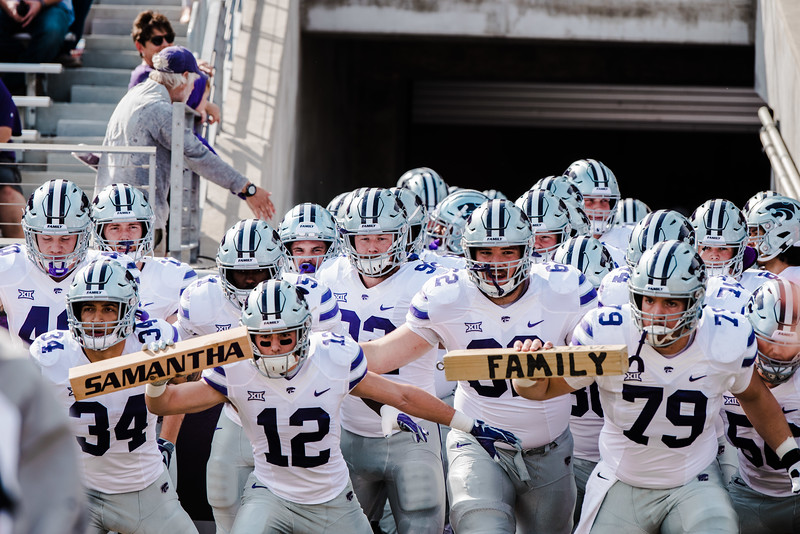 "K-State players rally together holding the ""family"" block as well as a ""Samantha"" block in honor of the K-State rower who recently died before the game against TCU Nov. 3. K-State lost against TCU 14-13. (Meg Shearer 