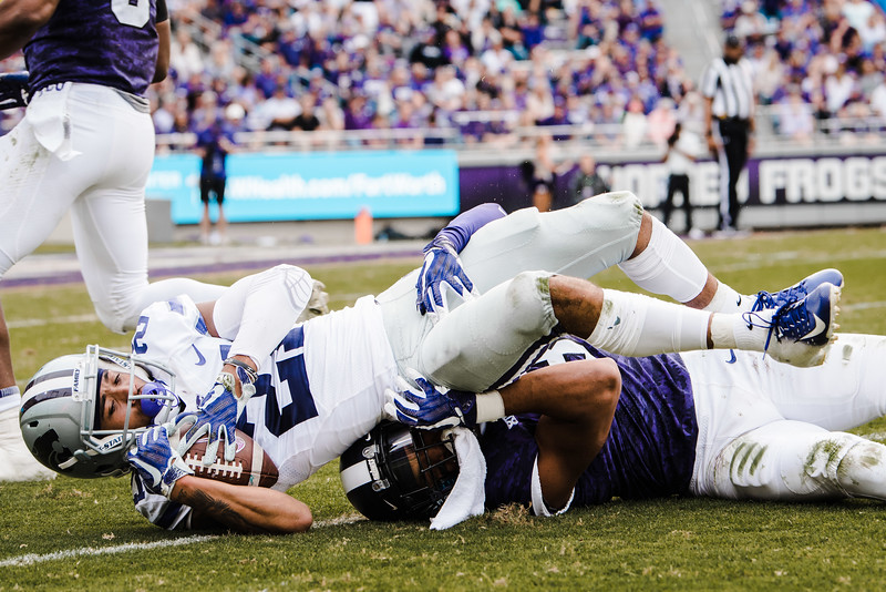 Wide receiver, Wykeen Gill gets tackled by a TCU defender during the game against TCU Nov. 3. K-State lost against TCU 14-13. (Meg Shearer | Collegian Media Group)