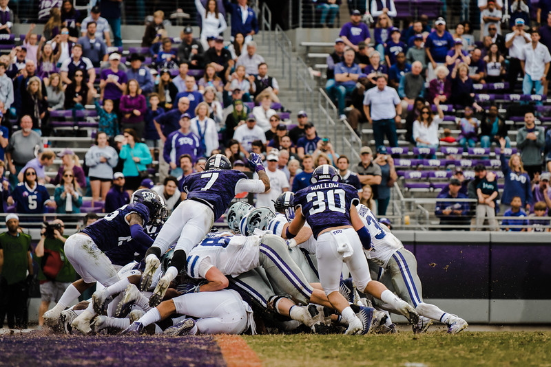 K-State players lunge forward to try to get a touchdown as TCU defenders fight for the ball during the game against TCU Nov. 3. K-State lost against TCU 14-13. (Meg Shearer | Collegian Media Group)