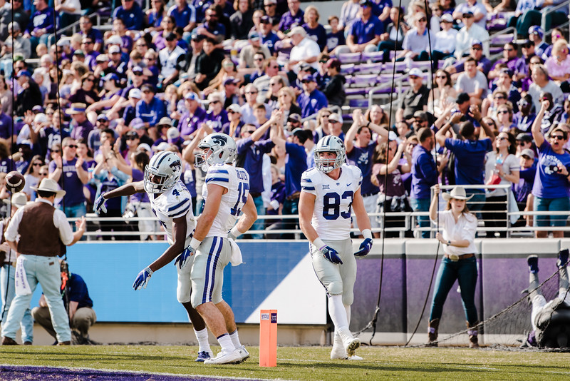 K-State players celebrate after wide reciever Malik Knowles scores the first touchdown of the game against TCU Nov. 3. (Meg Shearer | Collegian Media Group)