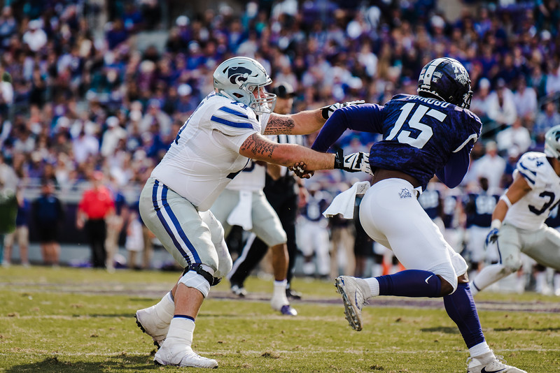 Offensive lineman, Dalton Risner attempts to block TCU defender at the game against TCU Nov. 3. K-State lost against TCU 14-13. (Meg Shearer | Collegian Media Group)