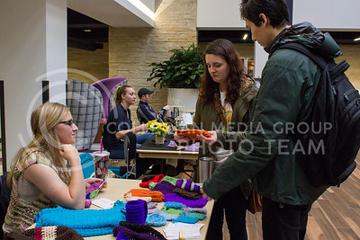 Hannah Luste, senior in biochemistry, and Tyler Penfield, masters student in environmental engineering, talk to Josie Hayes, masters student in accounting, at the farmers' market in the Student Union on March 29, 2017. (Maddie Domnick | The Collegian)
