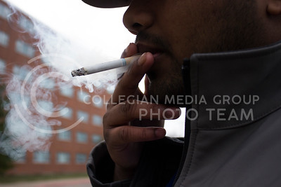 Student Tres Chatel, studying mechanical engineering takes a smoke break on March 14th, 2017 outside of one the dorm halls. (Kellly Pham | The Collegian)