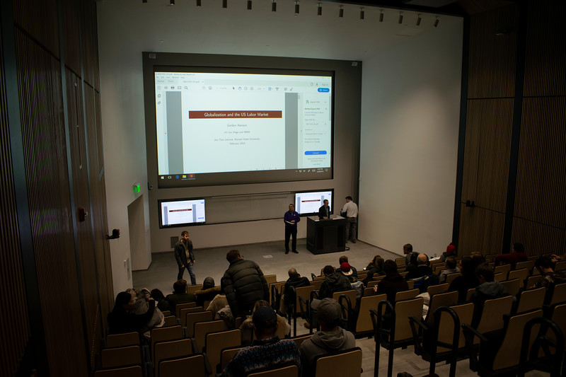 """The audience prepares for Dr. Gordon Hanson's lecture """"Globalization and the US Labor Market."""" (John Chapple 