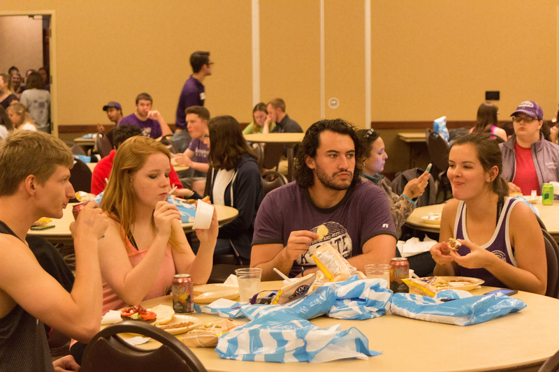 Seniors (from left to right) Jonathan Estes - Economics , Christine Loganbill - Graphic Design, Sam Moomaw - Communication Studies, and Erin Trainor - Economics, enjoy food and gift bags at the Grad Bash on May 3 at the Alumni Center. (Alex Masson | Collegian Media Group)