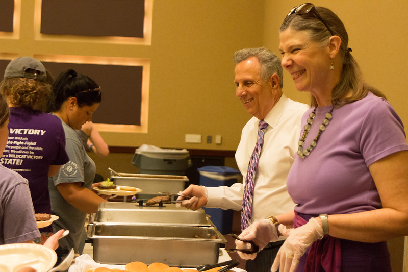 Provost April Mason and Pat Bosco, Dean of Students and Vice President of Student Life, serve food to students at the Grad Bash on May 3. (Alex Masson | Collegian Media Group)