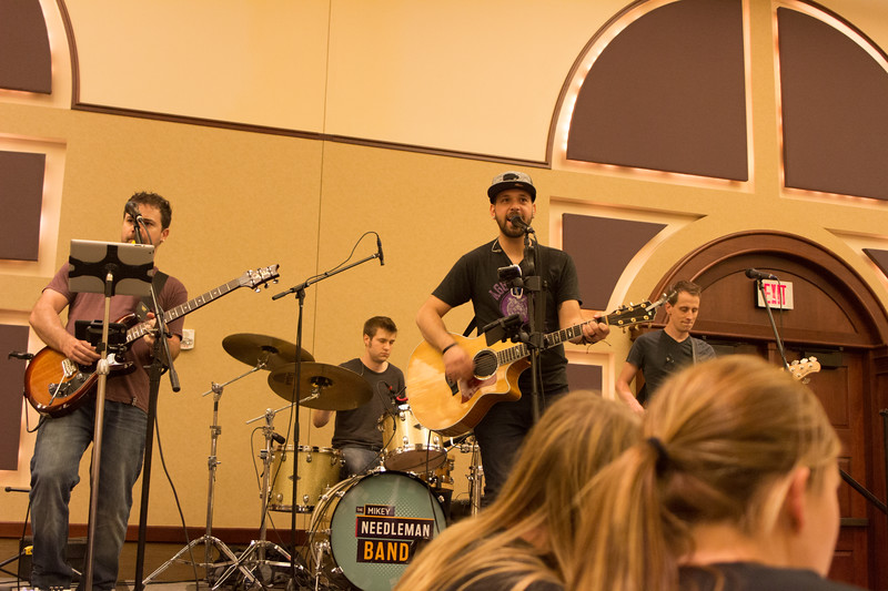 The Mikey Needleman Band, with lead signer Mikey Needleman, plays for the crowd at the Grad Bash on May 3 at the Alumni Center. (Alex Masson | Collegian Media Group)