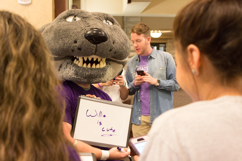 Willie the Wildcat visited seniors waiting to take photos at the Grad Bash on May 3 at the Alumni Center. (Alex Masson | Collegian Media Group)