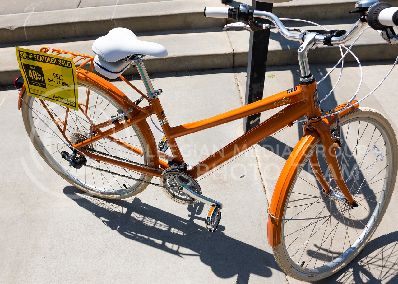 Pathfinder advertises their Alpine Shop with an orange bike at the Green Apple Bikes Ride2Campus event in Bosco Plaza on Apr. 24, 2017. (John Benfer | The Collegian)