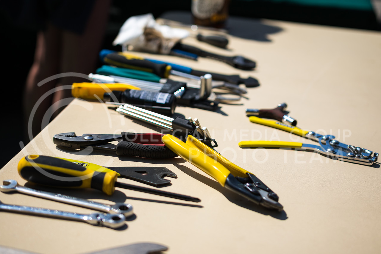 Brew Bros' Clint McAllister's tools scattered on a table at the Green Apple Bikes Ride2Campus event in Bosco Plaza on Apr. 24, 2017. (John Benfer | The Collegian)