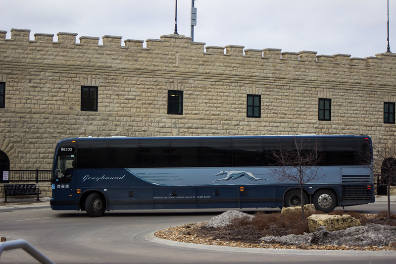 The 11:55 am Greyhound bus circles the roundabout next to the K-State parking garage as it leaves for Salina, KS. The Greyhound bus service runs once a day to Salina, KS and Kansas City, MO; with the Salina bus leaving at 11:55 am and the Kansas City bus leaving at 3:45 pm. The local bus stop is next to the K-State parking garage by the K-State Student Union.  (Sarah Millard | Collegian Media Group)