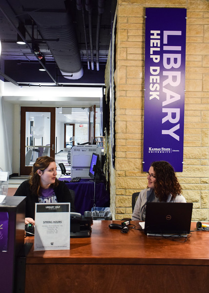 Krista Everhart, a secondary education major, and Stephanie Kirsey, an instructor at Hale Library, work the library help desk in the K-State Student Union. The help desk helps students borrow books for research and classes while Hale is being repaired.