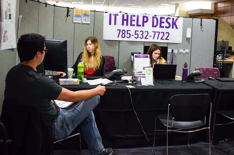 Courtney Porter, a senior in human development and family science, and Shannon Rose, sophomore in business administration, work at the IT Help Desk located on the top floor of the K-State Student Union. The help desk is available over the phone, in person and online.