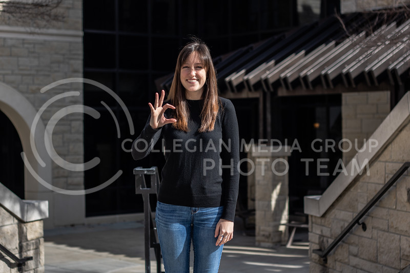 Hannah Sutherland, a 5th year senior in public relations and international studies posing in front of the Stanley School of Leadership with the Wildcat symbol.  (Sreenikhil Keshamoni | Collegian Media Group).