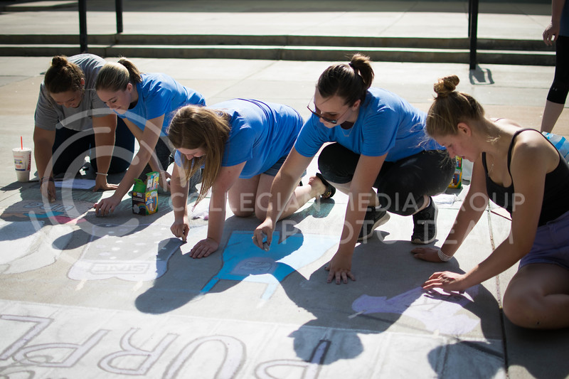 Members of the union program council draw for the chalking competition Oct. 16.<br /> (Meg Shearer   The Collegian)