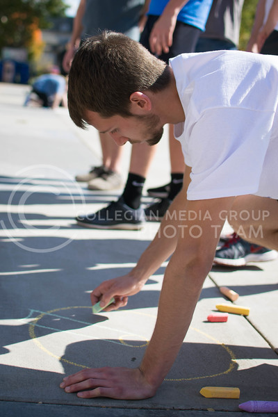 Dwight Pearson, junior in mechanical engineering, draw for the chalking competition Oct. 16.<br /> (Meg Shearer | The Collegian)