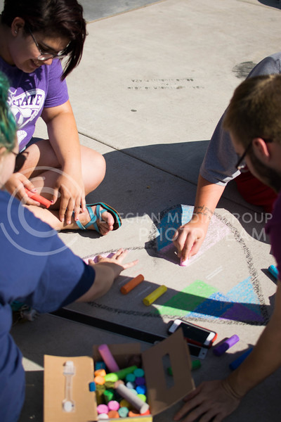 K-State sexuality and gender alliance club members work diligently on their chalk art on Oct. 16. <br /> (Meg Shearer | The Collegian)