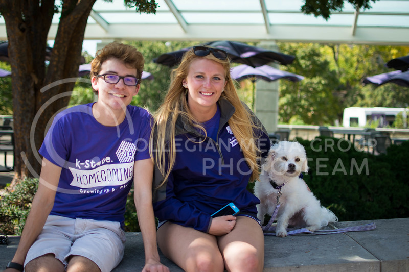 Homecoming committee interns, Andrew Nevins and Rachel Meyers watch the chalking competition Oct. 16.<br /> (Meg Shearer | The Collegian)