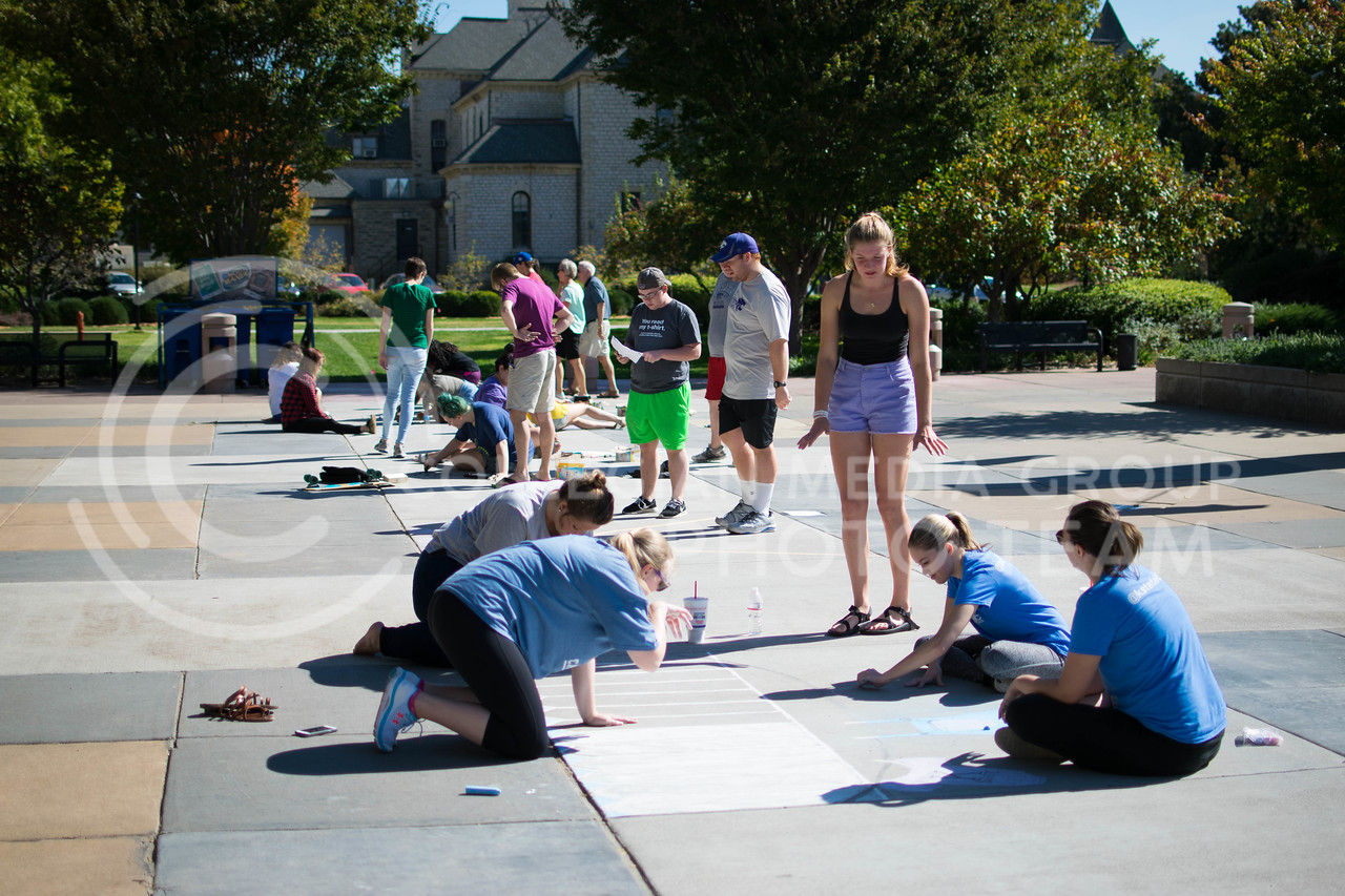 K-State students work on there drawings for the chalking competition Oct. 16.<br /> (Meg Shearer | The Collegian)