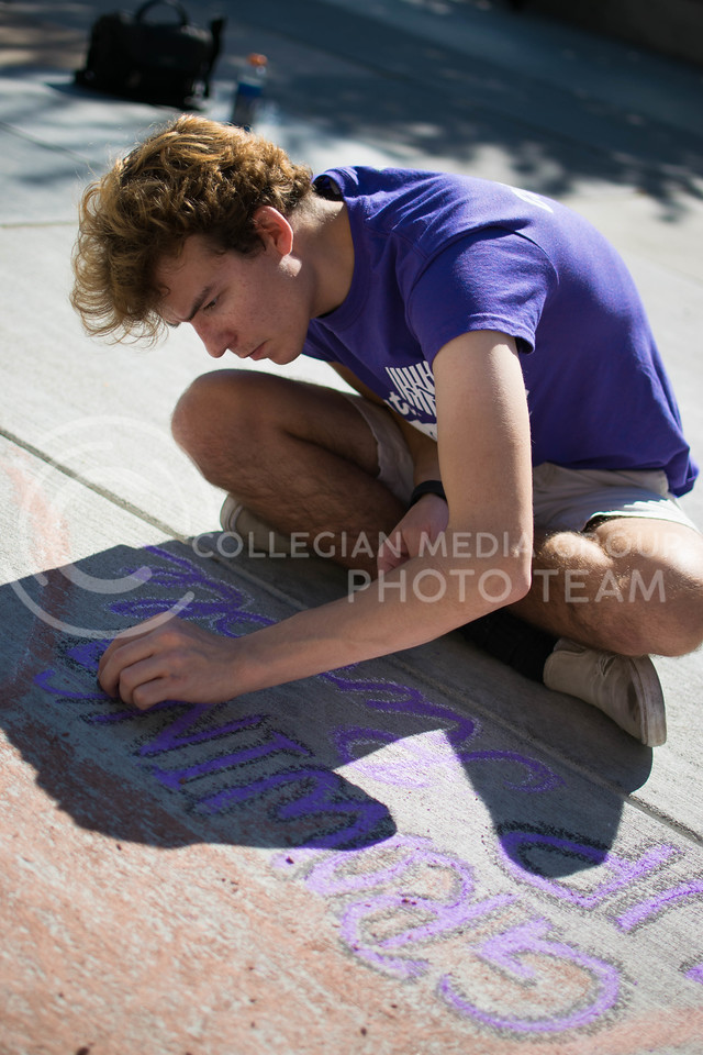 Andrew Nevins, junior in marketing, draw for the royal purple yearbook in the chalking competition Oct. 16.<br /> (Meg Shearer   The Collegian)