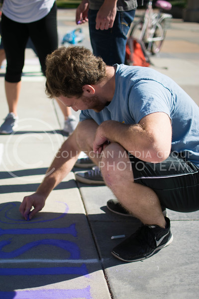 A member of Phi Sigma Pi draw for the chalking competition Oct. 16.<br /> (Meg Shearer | The Collegian)