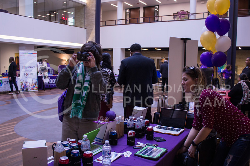 Isaiah Schmitt, a senior at McPherson High School looks through virtual reality glasses at the Housing Fair on Feb. 7, 2018 in the Union Courtyard. (Andrea Klepper   Collegian Media Group)