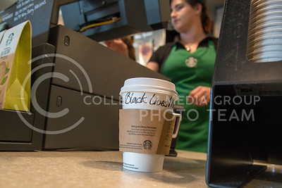 A Starbucks coffee cup on the counter reads 'Black Lives Matter' as Brittney Miller, Manhattan resident, rings up the order on July 19, 2016. (Evert Nelson | The Collegian)
