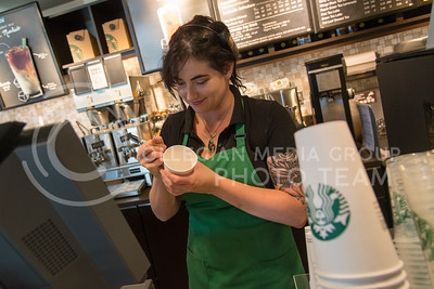 Brittney Miller, Manhattan resident, inscribes words on a Starbucks coffee cup on July 19, 2016 at the shop on Anderson Avenue. (Evert Nelson | The Collegian)