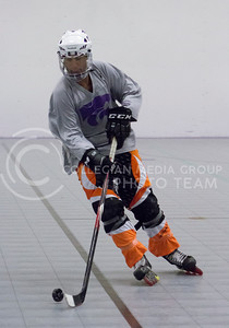 Avery Lambden, sophomore in aviation, practices his hockey skills for the Inline Hockey team at Chester E. Peters Recreation Center on Oct. 4, 2016. (Maddie Domnick | The Collegian)