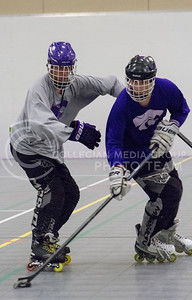 Nick Steiner, sophomore in biology, and Jake Schulte, junior in architectural engineering, go head-to-head at practice for the Inline Hockey team at Chester E. Peters Recreation Center on Oct. 4, 2016. (Maddie Domnick | The Collegian)