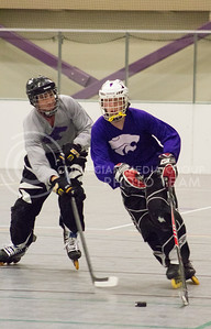 David Jacobson, sophomore in construction science and management, and Dylan Hugunin, senior in construction science, practice their hockey skills for the Inline Hockey team at Chester E. Peters Recreation Center on Oct. 4, 2016. (Maddie Domnick | The Collegian)