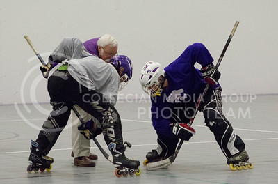 Nick Steiner, sophomore in biology, and David jacobson, sophomore in construction science and management, go head-to-head at practice for the Inline Hockey team at Chester E. Peters Recreation Center on Oct. 4, 2016. (Maddie Domnick | The Collegian)