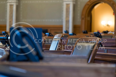 Wooden chairs line the desks for the 125 legislators in the House of Representatives in the Kansas State Capitol. (Photo by Evert Nelson   The Collegian)