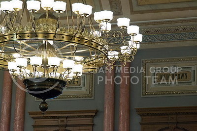 Chandaliers hang from the ceiling of the House of Representatives in front of prominate Kansas figures painted on the walls on June 9, 2016. (Photo by Evert Nelson   The Collegian)