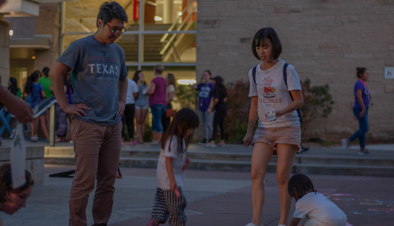 "Watching his daughters play with chalk Post Doctorate researcher Joe Chou said ""[Manhattan is] a very great place for family...my daughter can learn English, and learn everything from different cultures!"" (Rowan Jones 