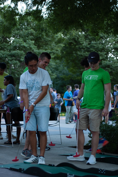 With intense focus senior Tony Lai an Animal Science major tries to putt the ball. Mini golf was set up to attract students to come to the International Block Party on August 24th, 2018. (Rowan Jones | Collegian Media Group)