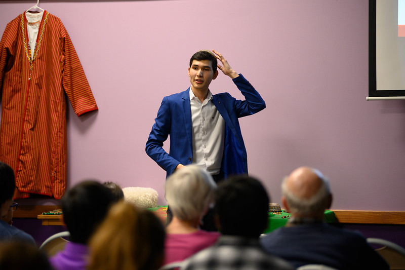 Yslam Akmyradov, a sophomore at K-State, shares facts about his home country, Turkmenistan, and the interesting places to visit for tourism while presenting at the International Student Center. Yslam shares history on the city of Merv, located in Central Asia and on the historical Silk Road. Oct 11, 2019. (Dylan Connell | Collegian Media Group)