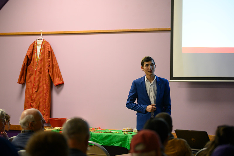 Yslam Akmyradov, a sophomore at K-State, shares facts about his home country, Turkmenistan, and the interesting places to visit for tourism while presenting at the International Student Center. Yslam lived in Turkmenistan until he decided to go to K-State to pursue Entrepreneurship and Organizational Management. Oct 11, 2019. (Dylan Connell | Collegian Media Group)