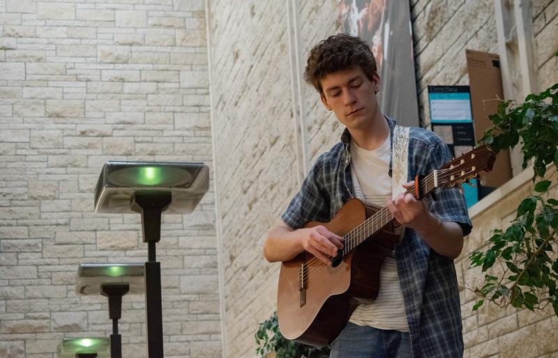 Jacob Thomas, freshman in music, practices guitar in the McCain Auditorium. (John Chapple   Collegian Media Group)