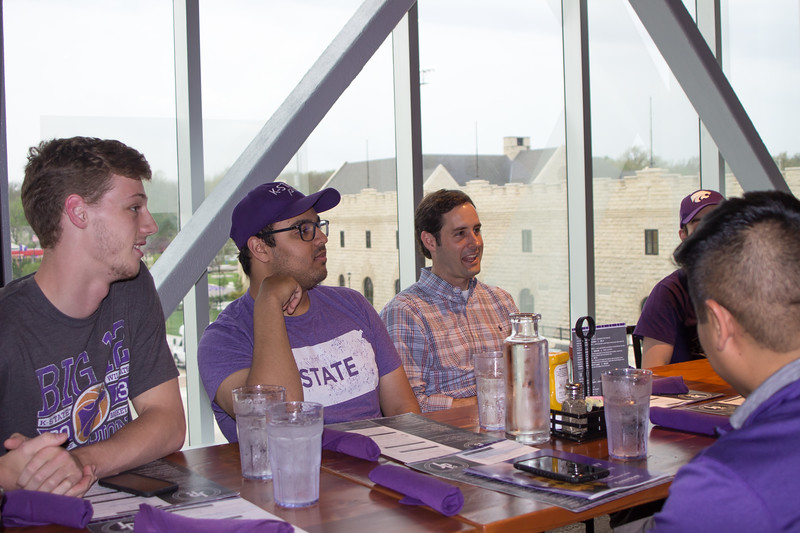 Atendees of the meet and greet hosted by Kansas State University Young Democrats talk politics with Democrat gubernatorial canidate Joshua Svaty. The meet and greet took place on Wednesday, May 2nd, at Union Station by JP's Gastropub.  (Sarah Millard | Collegian Media Group)