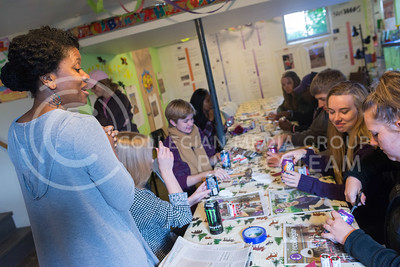 Dr. Kimetris Baltrip, assistant professor of journalism and mass communications, instructs her journalism class to explore ways of making a lightbulb out of provided materials at the Wonder Workshop Childrens Museum in Manhattan on October 13, 2016. (Evert Nelson | The Collegian)