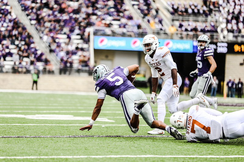 Quarterback, Alex Delton, embraces himself for a fall during the game against Texas in Bill Snyder Family Stadium on Sept. 29, 2018. The Wildcats fell to the Longhorns 19-14. (Emily Lenk | Collegian Media Group)
