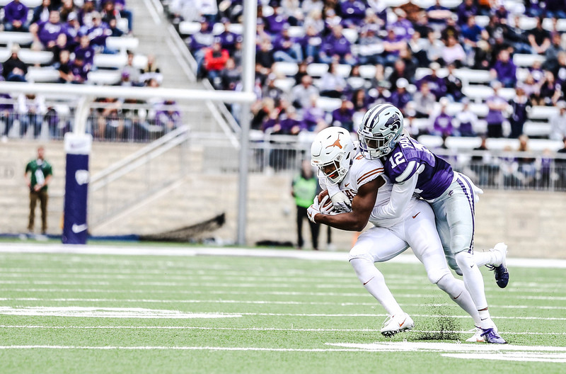 Defensive back, AJ Parker, makes a tackle during the game against Texas in Bill Snyder Family Stadium on Sept. 29, 2018. The Wildcats fell to the Longhorns 19-14. (Emily Lenk | Collegian Media Group)