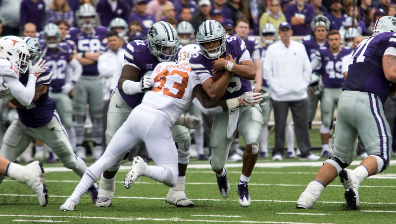 Junior quarterback, Alex Delton runs with the ball up field during the game against Texas on September 29, 2018 at Bill Snyder Family Stadium. (Sabrina Cline | Collegian Media Group)