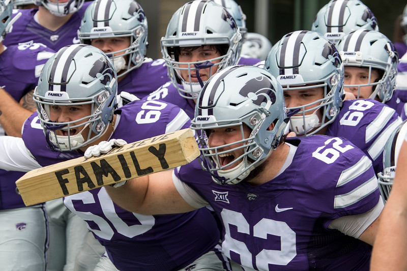 The players sway and shout as they get hyped up for the start of the game against Texas on September 29, 2018 at Bill Snyder Family Stadium. (Sabrina Cline | Collegian Media Group)
