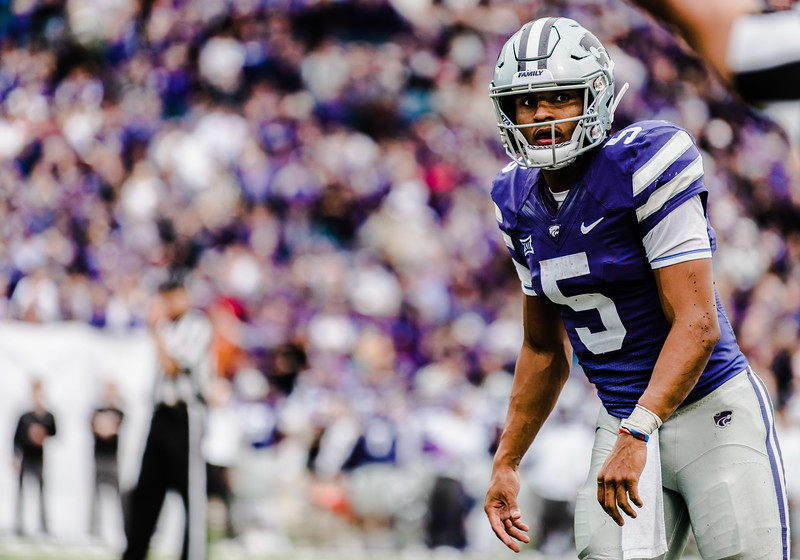 Quarterback Alex Delton looks at his coaches for his next play during the game against Texas in Bill Snyder Family Stadium on Sept. 29, 2018. The Wildcats fell to the Longhorns 19-14. (Meg Shearer | Collegian Media Group)