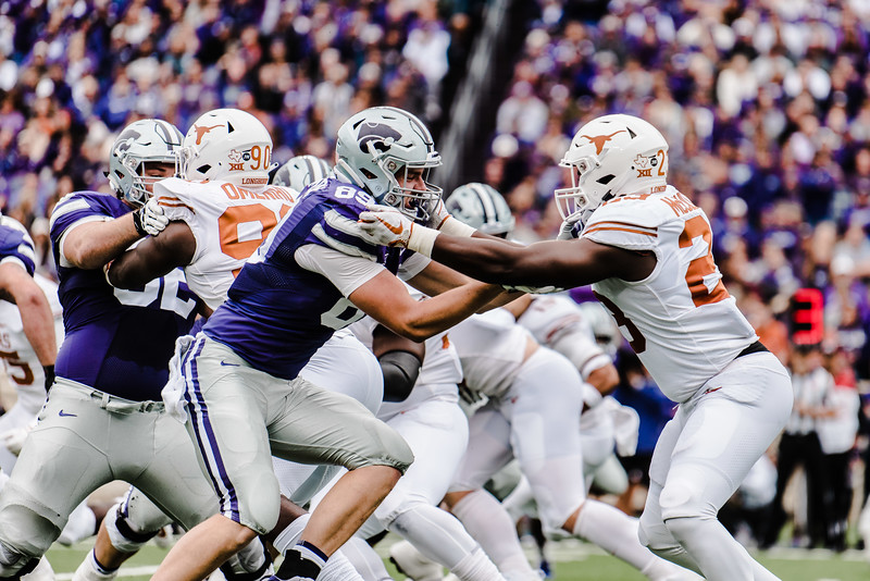 Tight end Blaise Gammon pushes a defender off the line during the game against Texas in Bill Snyder Family Stadium on Sept. 29, 2018. The Wildcats fell to the Longhorns 19-14. (Meg Shearer | Collegian Media Group)