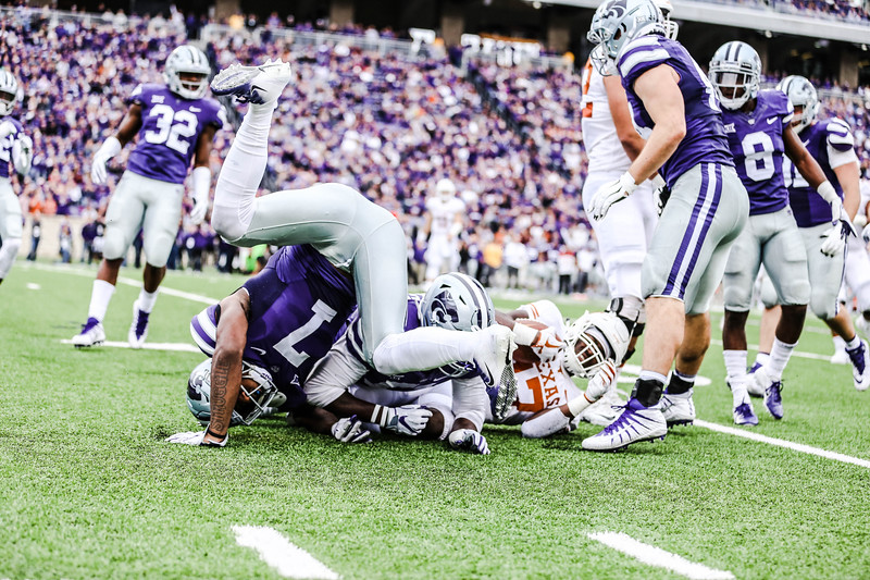 Eli Walker tumbles as he goes for a tackle during the game against Texas in Bill Snyder Family Stadium on Sept. 29, 2018. The Wildcats fell to the Longhorns 19-14. (Emily Lenk | Collegian Media Group)